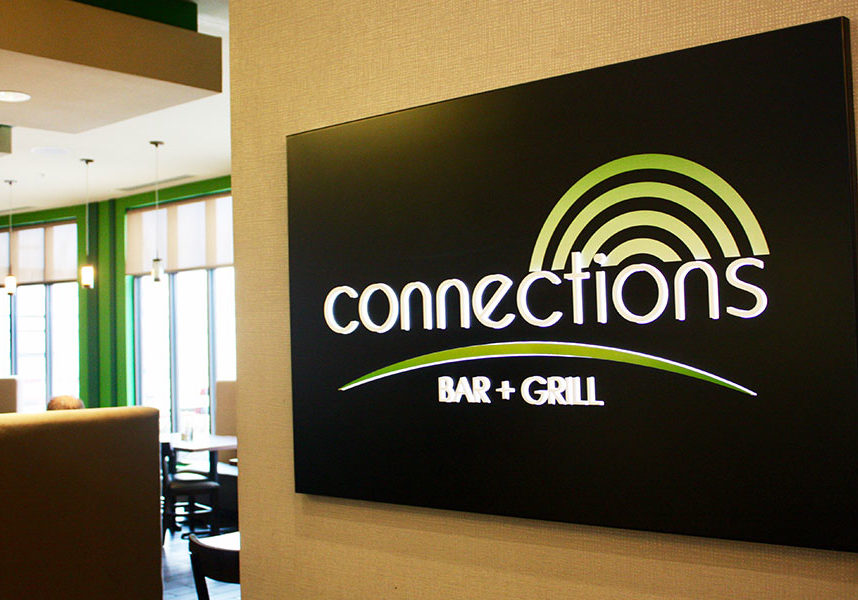 interior signage for connections bar + grill
